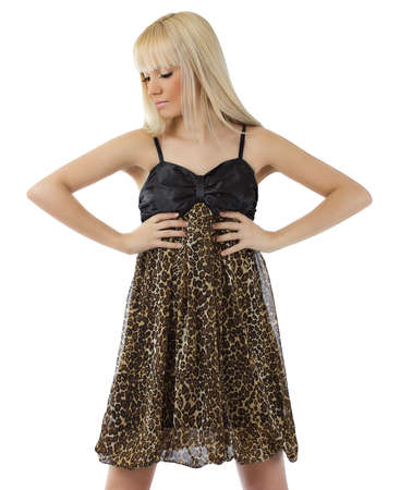 Beautiful blond girl posing sexy leopard dress isolated on white background photo