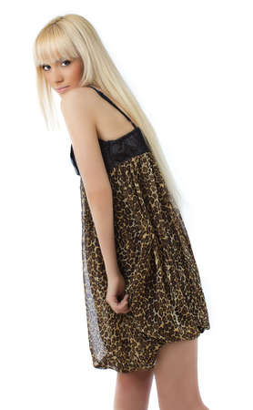 Beautiful young girl with long blond hair posing sexy leopard dress on white background photo