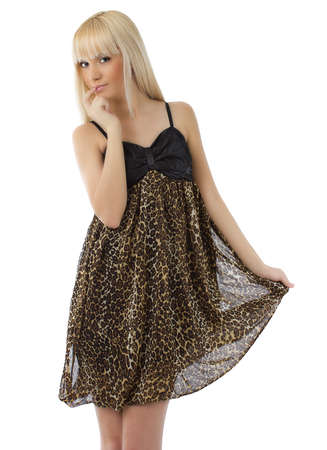 Beautiful young girl with long blond hair wearing sexy leopard dress on white background photo