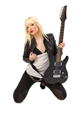Sexy beautiful blonde woman posing with black electric guitar on white background Stock Photo - 14729596