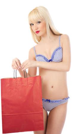 Beautiful blonde woman in lingerie with shopping bag on white background photo