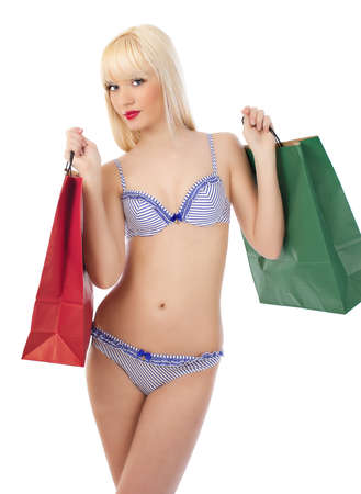 Picture of seductive woman in sexy lingerie with shopping bags on white background photo