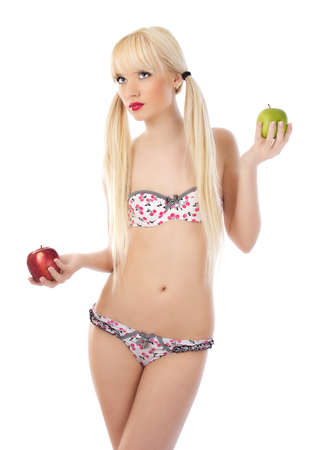 Sexy blonde woman in lingerie holding apples on white background Stock Photo - 14729558