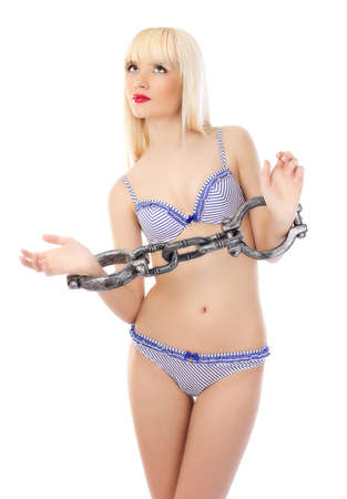 shackled: Mujer sexy en ropa interior con cadenas sobre fondo blanco