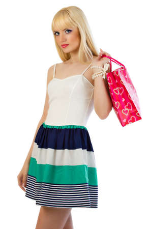 Blonde woman in dress with a bag on white background