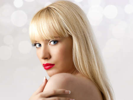 Portrait of young beautiful blonde woman with red lips isolated on white photo