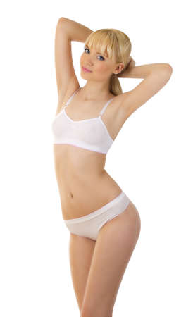 is slender: Pretty sporty woman in undrewear over white Stock Photo