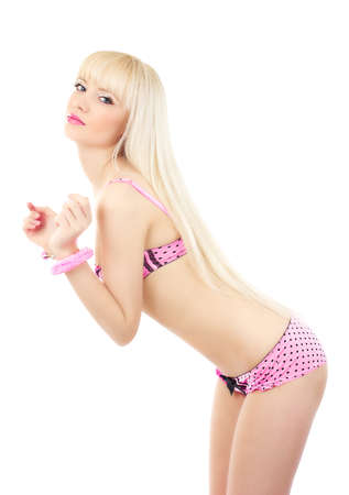 Sexy beautiful blonde girl wearing pink lingerie with handcuffs isolated on white background Stock Photo - 15629655