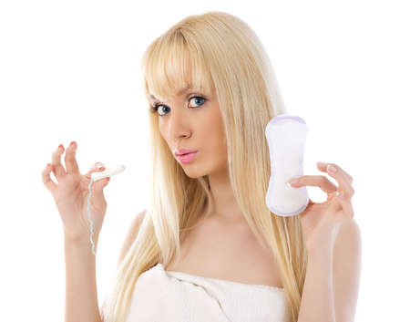 Pretty woman holding cotton hygienic tampon Stock Photo