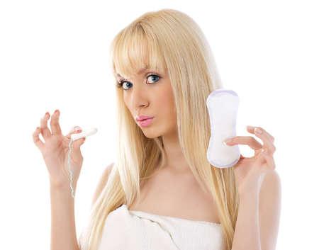 Pretty woman holding cotton hygienic tampon 版權商用圖片