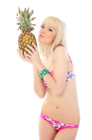 Beautiful woman holding pineapple on white background photo