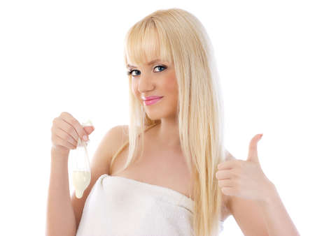 Pretty woman holding condom and giving thumbs up on white background