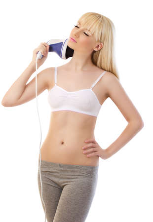 massager: Beautiful blonde woman using massager on white background