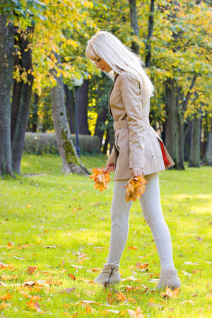 trench: Beautiful woman walking in park