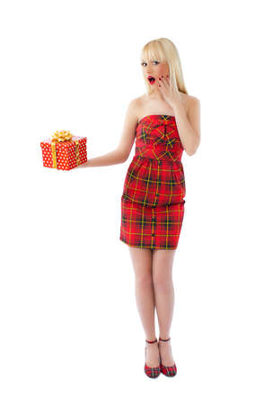scottish female: Beautiful young blonde model posing in red dress on white background Stock Photo