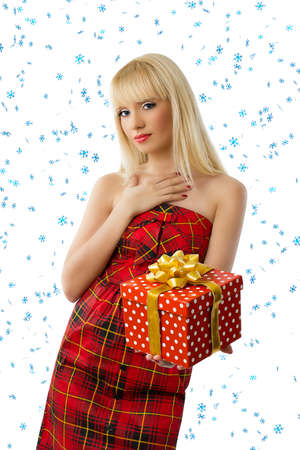 Beautiful blonde woman with christmas gift. Snowflakes Stock Photo - 15812088