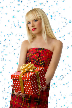Blonde woman with christmas gift. Snowflakes Stock Photo - 15812097