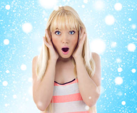 Woman looking surprise. Snowflakes photo