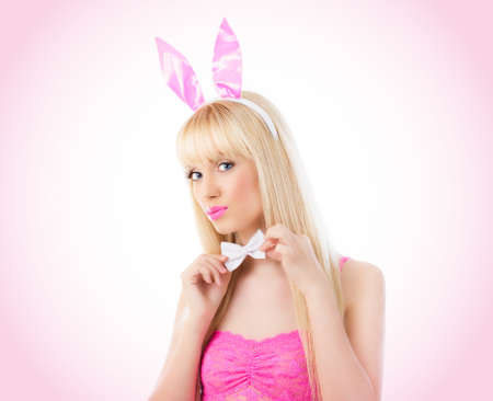 Beautiful blonde young woman in bunny ears Stock Photo