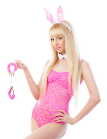 handcuffs female: Beautiful blonde young woman in bunny ears with handcuffs Stock Photo