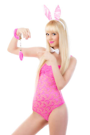 Beautiful blonde young woman in bunny ears with handcuffs Stock Photo - 16248600