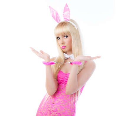 Beautiful blonde young woman in bunny ears with handcuffs Stock Photo