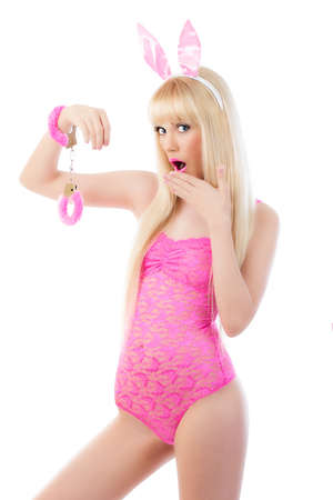 Beautiful blonde young woman in bunny ears with handcuffs photo