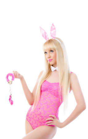handcuffs girl: Beautiful blonde young woman in bunny ears with handcuffs Stock Photo