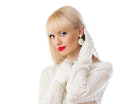 Beautiful woman in white sweater with red lips on white background photo