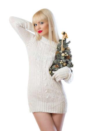 Beautiful woman holding small christmas tree on white background Stock Photo - 16551577