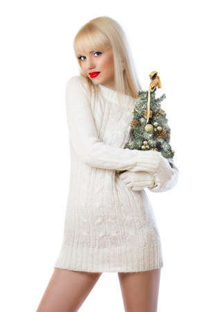 Pretty blonde woman holding small christmas tree on white background photo