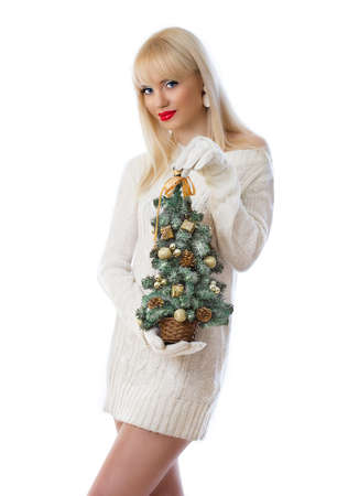 Pretty woman holding small christmas tree on white background photo