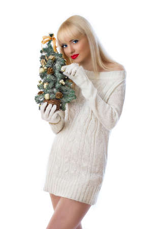 Pretty young woman holding small christmas tree on white background Stock Photo - 16551574