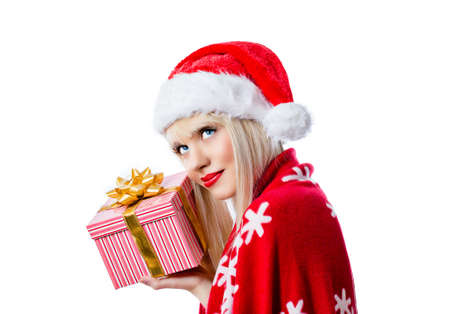 Beautiful blonde girl holding christmas gift in red hat on white background Stock Photo - 16756279