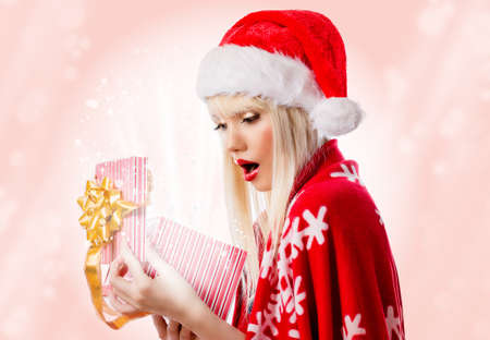 Pretty blonde young woman in red hat with opened gift box Stock Photo - 16756281
