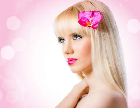 Beautiful blonde woman with orchid flower Stock Photo - 16830224
