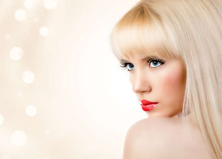 Beautiful blonde young woman with red lips photo