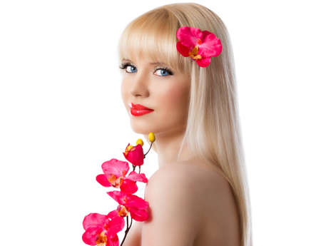 Pretty blonde girl with red orchid flowers on white background Stock Photo - 16909137