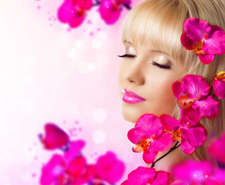 Beautiful blonde young woman with flowers