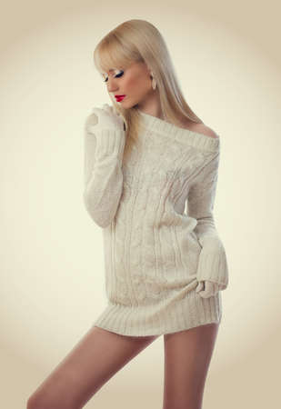 Beautiful blonde woman in knitted dress  Stock Photo