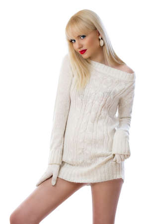 Beautiful young woman in knitted dress on white background