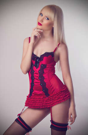 Beautiful and sexy woman wearing red lingerie photo