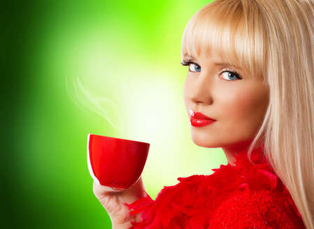 Beautiful blonde young woman with coffee photo