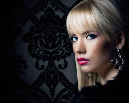 Beautiful blonde young woman in luxury fur coat Stock Photo - 18299646