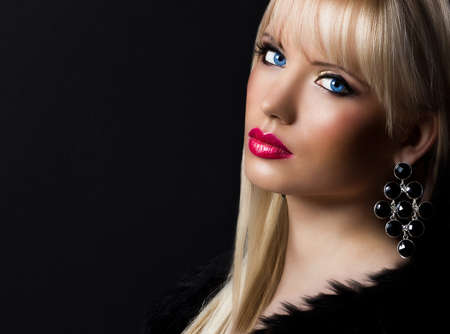 earings: Beautiful blonde woman with perfect makeup