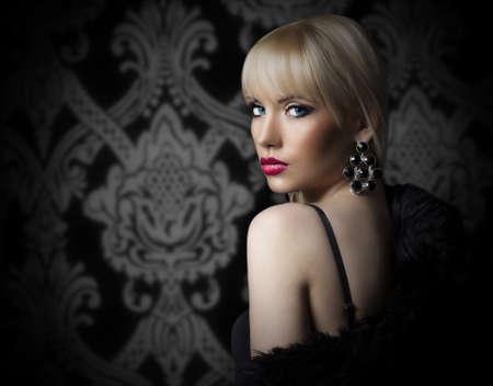 Portrait of beautiful woman in luxury fur coat Stock Photo