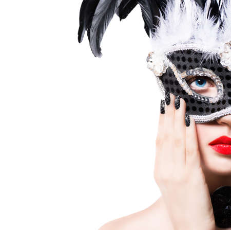 Beautiful girl in black carnival mask with manicure on white background Stock Photo