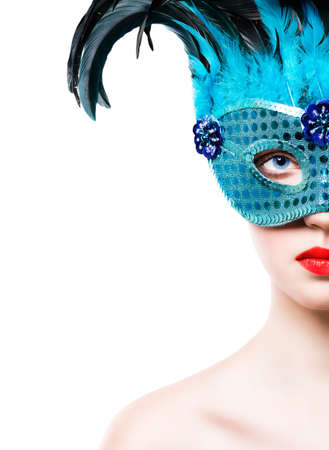 Beautiful young woman in blue carnival mask on white background photo