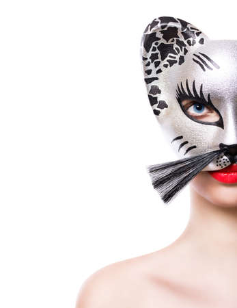 Beautiful young woman in cat mask photo
