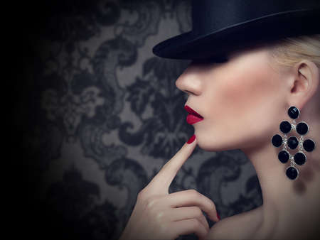 Beautiful blonde woman with red lips and manicure   Stock Photo